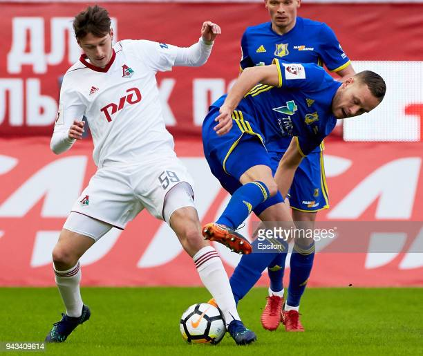 Aleksei Miranchuk of FC Lokomotiv Moscow and Sverrir Ingi Ingason of FC Rostov RostovonDon vie for the ball during the Russian Football League match...