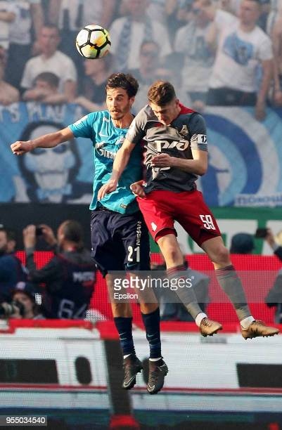 Aleksei Miranchuk of FC Lokomotiv Moscow vie for the ball with Aleksandr Yerokhin of FC Zenit Saint Petersburg during the Russian Football League...