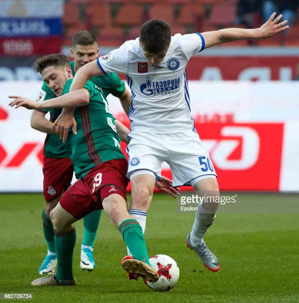 Aleksei Miranchuk of FC Lokomotiv Moscow vies for the ball with Stanislaw Drahun of FC Orenburg during the Russian Premier League match between FC...