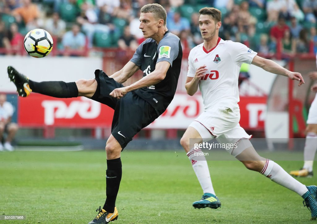 Aleksei Miranchuk of FC Lokomotiv Moscow vies for the ball with Vitali Shakhov of FC Tosno Khabarovsk during the Russian Premier League match between FC Lokomotiv Moscow and FC Tosno at Lokomotiv stadium on August 13, 2017 in Moscow, Russia.