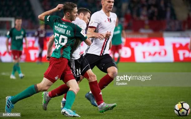 Aleksei Miranchuk of FC Lokomotiv Moscow vies for the ball with Syarhey Balanovich of FC Amkar Perm during the Russian Premier League match between...