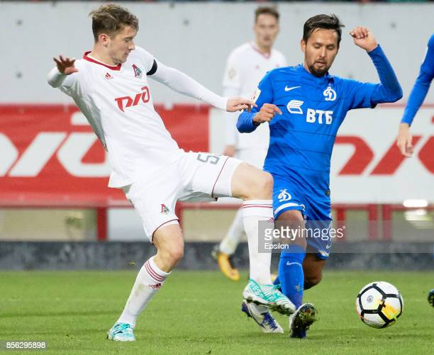 Aleksei Miranchuk of FC Lokomotiv Moscow vies for the ball with Alexander Zotov of FC Dinamo Moscow during the Russian Premier League match between...