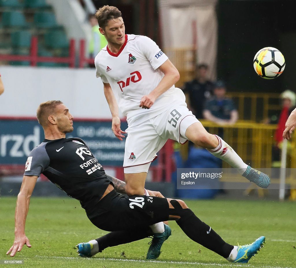 Aleksei Miranchuk of FC Lokomotiv Moscow vies for the ball with Rade Dugalich of FC Tosno Khabarovsk during the Russian Premier League match between FC Lokomotiv Moscow and FC Tosno at Lokomotiv stadium on August 13, 2017 in Moscow, Russia.