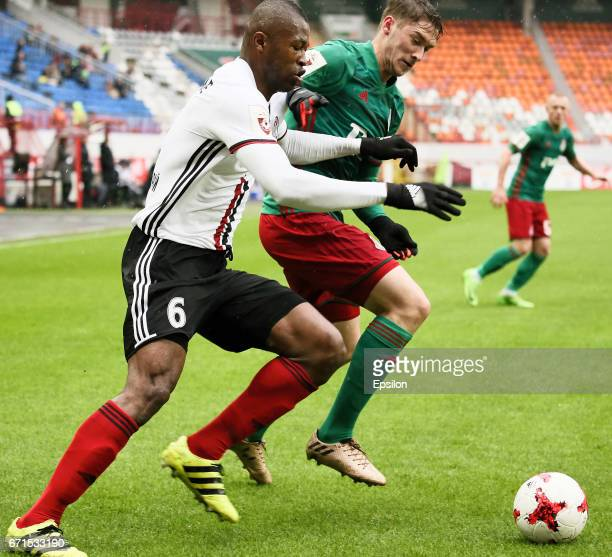 Aleksei Miranchuk of FC Lokomotiv Moscow vies for the ball with Sekou Conde of FC Amkar Perm during the Russian Premier League match between FC...