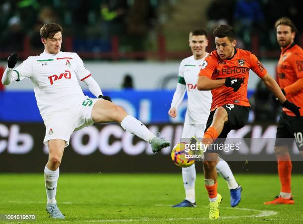 Aleksei Miranchuk of FC Lokomotiv Moscow vies for the ball with Yury Bavin of FC Ural Ekaterinburg during the Russian Premier League match between FC...