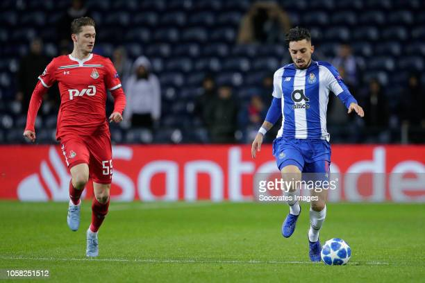 Aleksei Miranchuk of Lokomotiv Moscow Alex Telles of Porto during the UEFA Champions League match between FC Porto v Lokomotiv Moscow at the Estadio...