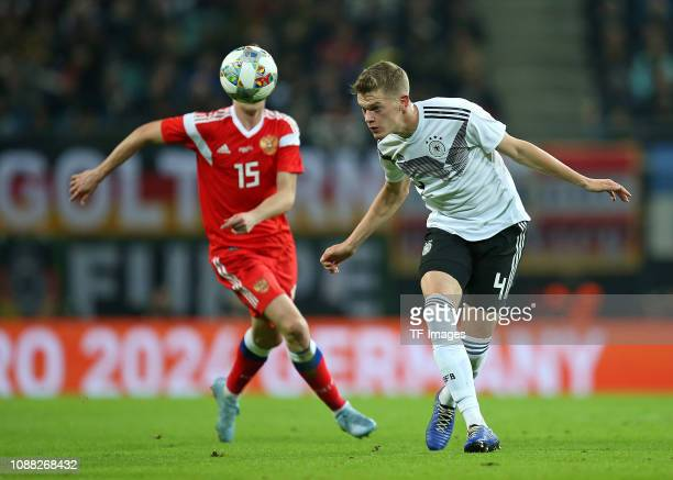 Aleksei Miranchuk of Russia and Matthias Ginter of Germany battle for the ball during the International Friendly match between Germany and Russia at...