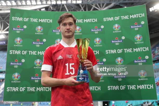 """Aleksei Miranchuk of Russia poses for a photograph with their Heineken """"Star of the Match"""" award after the UEFA Euro 2020 Championship Group B match..."""