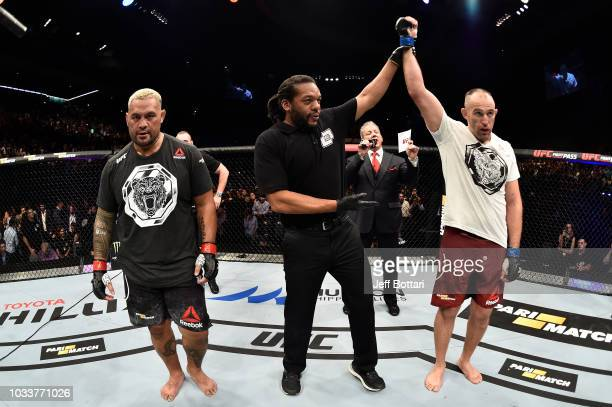 Aleksei Oleinik of Russia celebrates his submission victory over Mark Hunt of New Zealand in their heavyweight bout during the UFC Fight Night event...