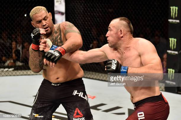 Aleksei Oleinik of Russia punches Mark Hunt of New Zealand in their heavyweight bout during the UFC Fight Night event at Olimpiysky Arena on...