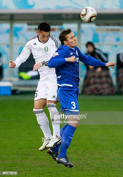 Aleksei Rebko of FC Dinamo Moskva battles for the ball with Kim NamIl of FC Tom Tomsk during the Russian Football League Championship match between...