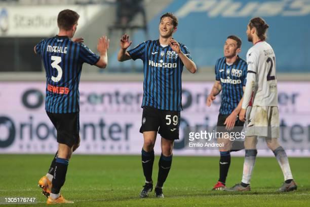 Aleksej Miranchuk of Atalanta B.C. Celebrates with Joakim Maehle after scoring their sides fifth goal during the Serie A match between Atalanta BC...