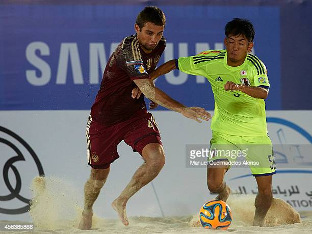 Aleksey Makarov of Russia competes for the ball with Shotaro Haraguchi of Japan during day one of the Beach Soccer Intercontinental Cup 2014 match...