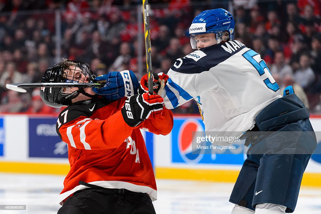 Aleksi Makela #5 of Team Finland hits Connor McDavid #17 of Team Canada during the 2015 IIHF World Junior Hockey Championship game at the Bell Centre on December 29, 2014 in Montreal, Quebec, Canada. Team Canada defeated Team Finland 4-1.