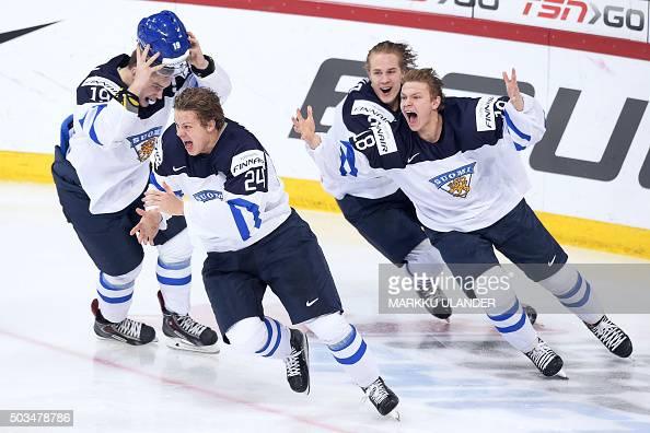 Aleksi Saarela Kasperi Kapanen and Vili Saarijärvi of Finland celebrate the world championship at the of the 2016 IIHF World Junior Ice Hockey...