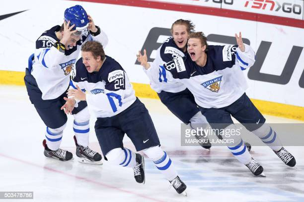 Aleksi Saarela Kasperi Kapanen and Vili Saarijärvi of Finland celebrate the world championship at the of the 2016 IIHF World Junior Ice Hockey...