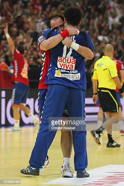 Alem Toskic and Darko Stanic of Serbia celebrate the 2622 victory after the Men's European Handball Championship second semi final match between...