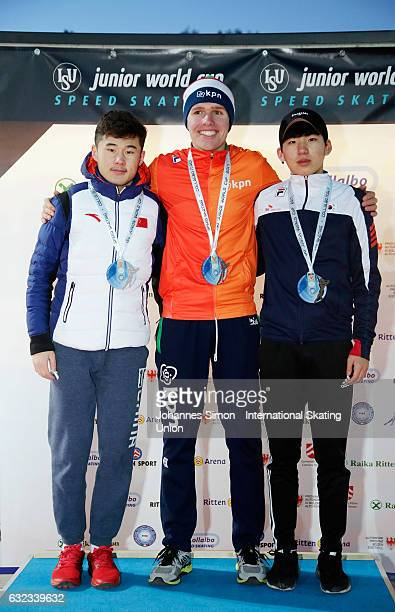 Alemasi Kahanbai of China Marwin Talsma of the Netherlands and Jaewon Chung of Korea pose during the medal ceremony after winning the men's junior...