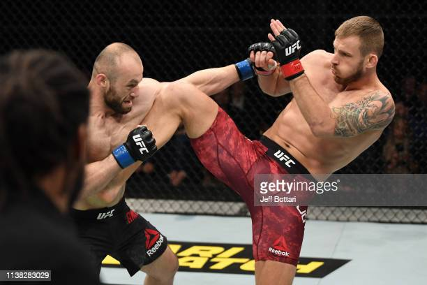 Alen Amedovski of Macedonia and Krzysztof Jotko of Poland exchange strikes in their middleweight bout during the UFC Fight Night event at Yubileyny...