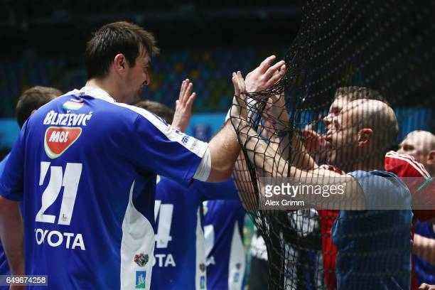 Alen Blazevic of Szeged and team mates celebrate with the fans after the EHF Champions League match between Rhein Neckar Loewen and MolPick Szeged at...