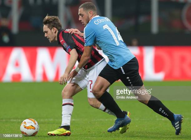 Alen Halilovic of AC Milan is challenged by Clement Couturier of F91 Dudelange during the UEFA Europa League Group F match between AC Milan and F91...