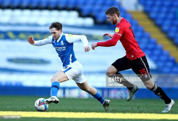Alen Halilovic of Birmingham City battles with Sam Field of Queens Park Rangers during the Sky Bet Championship match between Birmingham City and...