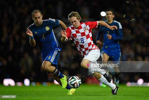 Alen Halilovic of Croatia is challenged by Pablo Zabaleta of Argentina during an International Friendly between Argentina and Croatia at Boleyn...