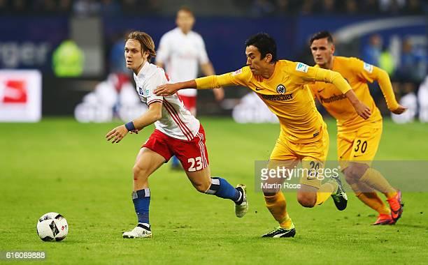 Alen Halilovic of Hamburg and Makoto Hasebe of Frankfurt battle for the ball during the Bundesliga match between Hamburger SV and Eintracht Frankfurt...