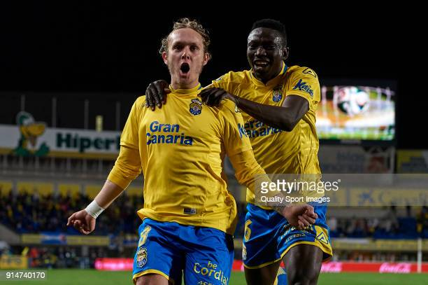 Alen Halilovic of Las Palmas celebrates after scoring his sides first goal with his teammate Oghenekaro Etebo during the La Liga match between Las...