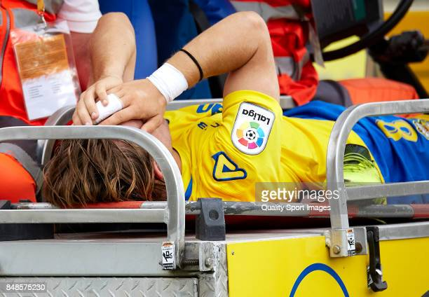Alen Halilovic of Las Palmas shows his emotion while being taken off by a stretcher during the La Liga match between Las Palmas and Athletic Club at...