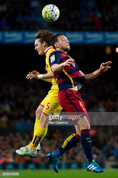 Alen Halilovic of Sporting Gijon and Ivan Rakitic of FC Barcelona compete for the ball during the La Liga match between FC Barcelona and Sporting...
