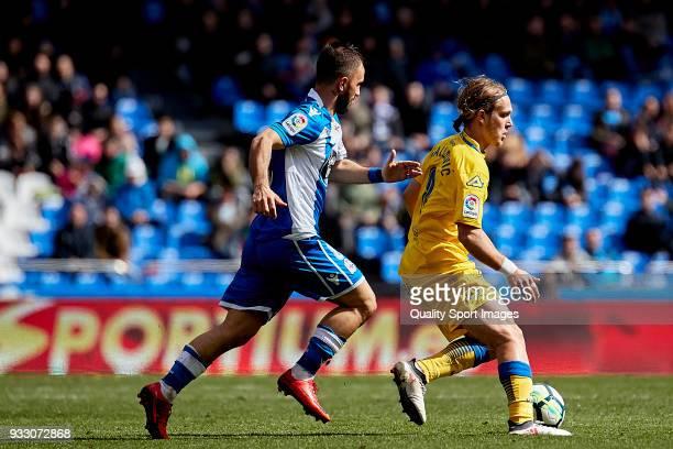 Alen Halilovic of UD Las Palmas is challenged by Emre Çolak of Deportivo de La Coruna during the La Liga match between Deportivo La Coruna and Las...