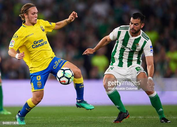 Alen Halilovic of Union Deportiva Las Palmas being followed by Jordi Amat of Real Betis Balompie during the La Liga match between Real Betis and Las...
