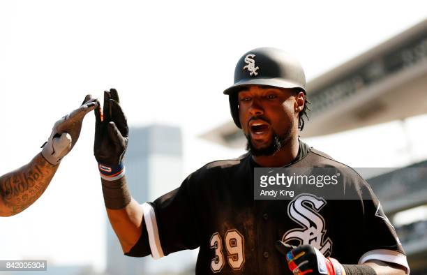 Alen Hanson of the Chicago White is congratulated after hitting a home run against the Minnesota Twins in the ninth inning during of their baseball...