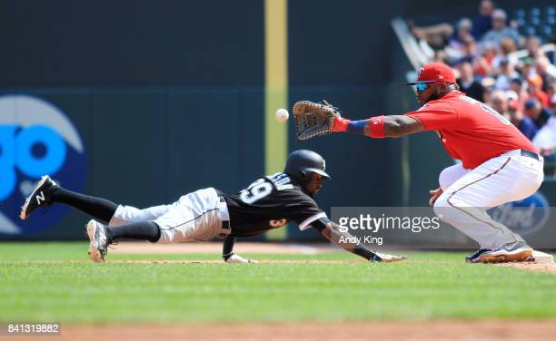 Alen Hanson of the Chicago White Sox dives by to first base with Kennys Vargas of Minnesota Twins catching in the fourth inning during of their...