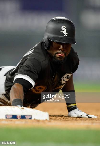 Alen Hanson of the Chicago White Sox dives safely back to first base against the Minnesota Twins during the game on August 30 2017 at Target Field in...