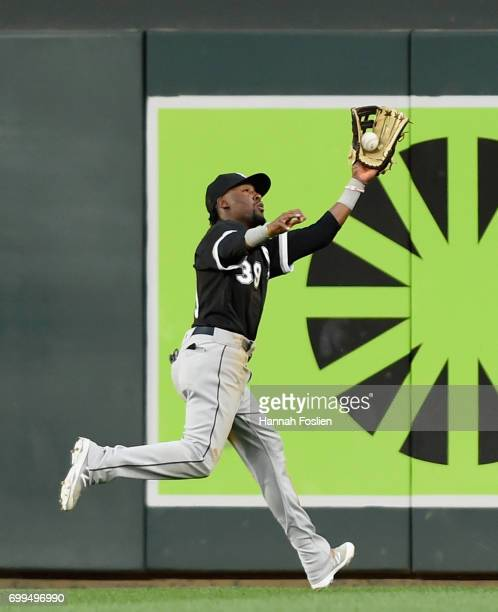 Alen Hanson of the Chicago White Sox makes a catching right field of the ball hit by Eduardo Escobar of the Minnesota Twins during the fourth inning...