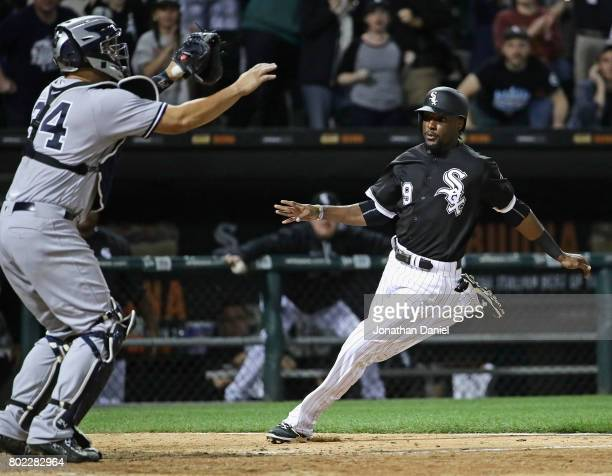 Alen Hanson of the Chicago White Sox moves in to score the winning run as Gary Sanchez of the New York Yankees awaits the throw at Guaranteed Rate...