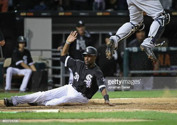 Alen Hanson of the Chicago White Sox moves in to score the winning run as Gary Sanchez of the New York Yankees leaps for the ball at Guaranteed Rate...
