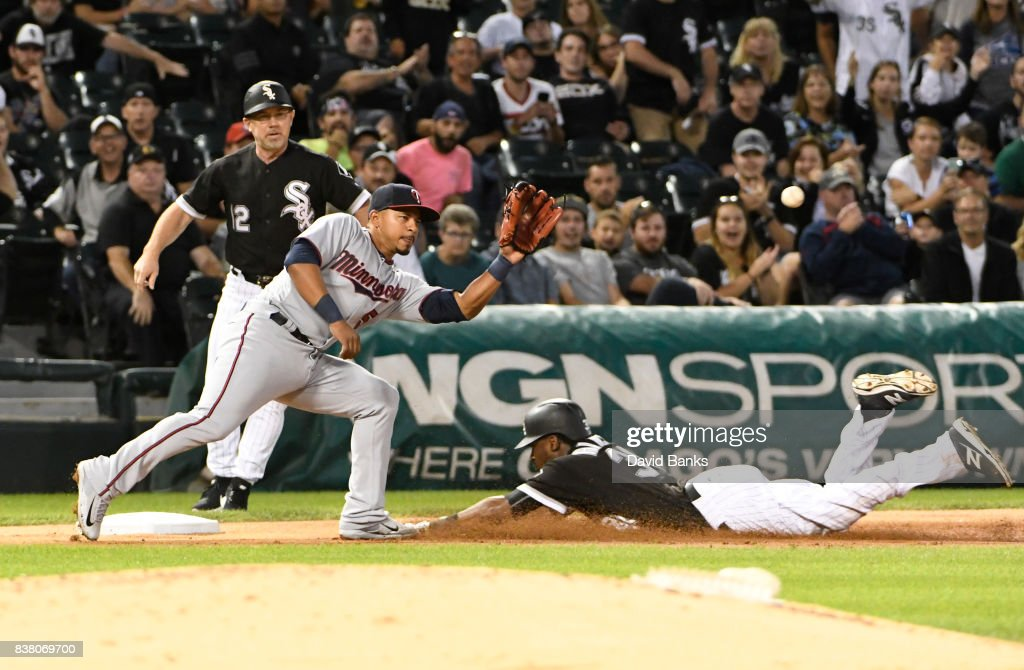 Alen Hanson #39 of the Chicago White Sox slides safely into third base with a triple as Eduardo Escobar #5 of the Minnesota Twins takes the throw during the third inning on August 23, 2017 at Guaranteed Rate Field in Chicago, Illinois.