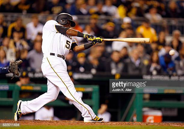 Alen Hanson of the Pittsburgh Pirates records his first Major League hit in the fifth inning during the game against the Atlanta Braves at PNC Park...