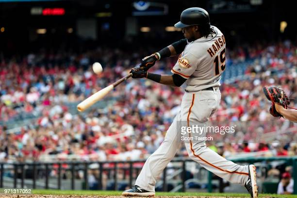 Alen Hanson of the San Francisco Giants at bat against the Washington Nationals during the seventh inning at Nationals Park on June 10 2018 in...
