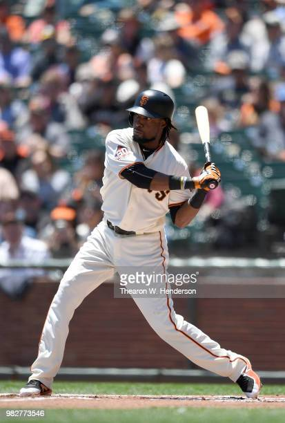 Alen Hanson of the San Francisco Giants bats against the Miami Marlins in the bottom of the first inning at ATT Park on June 20 2018 in San Francisco...