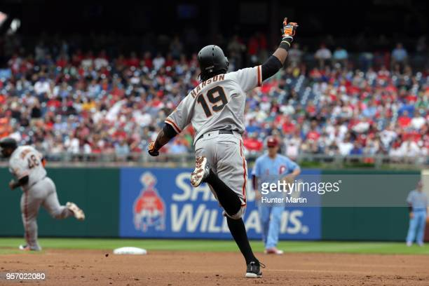 Alen Hanson of the San Francisco Giants celebrates after hitting a tworun home run in the second inning during a game against the Philadelphia...