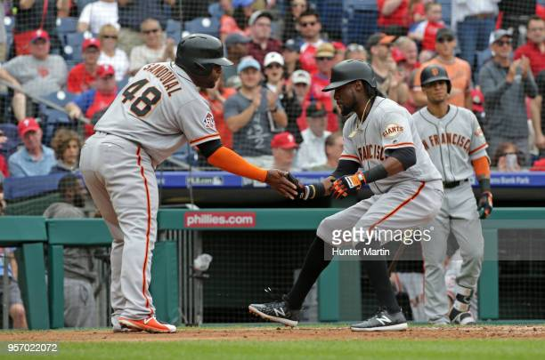 Alen Hanson of the San Francisco Giants celebrates with Pablo Sandoval after hitting a tworun home run in the second inning during a game against the...