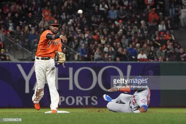 Alen Hanson of the San Francisco Giants completes the doubleplay throwing over the top of Austin Jackson of the New York Mets in the top of the...