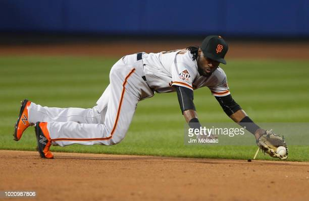 Alen Hanson of the San Francisco Giants fields the ball for the final out of the second inning against the New York Mets at Citi Field on August 21...