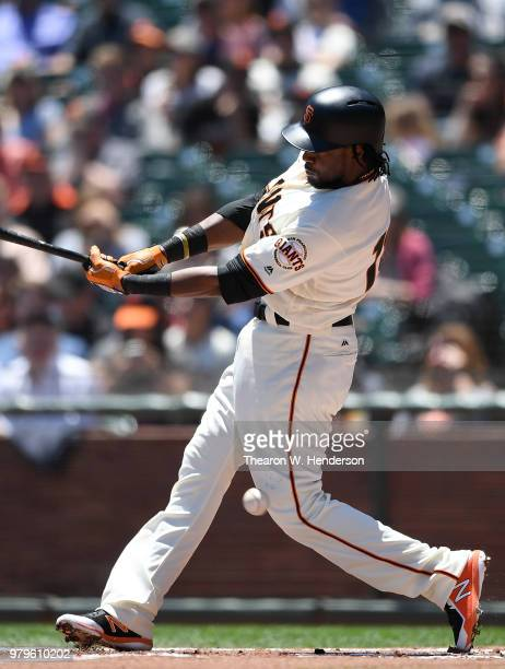 Alen Hanson of the San Francisco Giants fouls a pitch off the top of his knee against the Miami Marlins in the bottom of the first inning at ATT Park...
