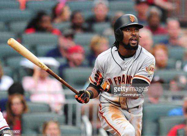 Alen Hanson of the San Francisco Giants hits a fourth inning tworun home run against the Atlanta Braves at SunTrust Park on May 5 2018 in Atlanta...