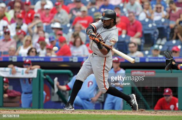 Alen Hanson of the San Francisco Giants hits a ground ball to second base during his at bat in the seventh inning during a game against the...